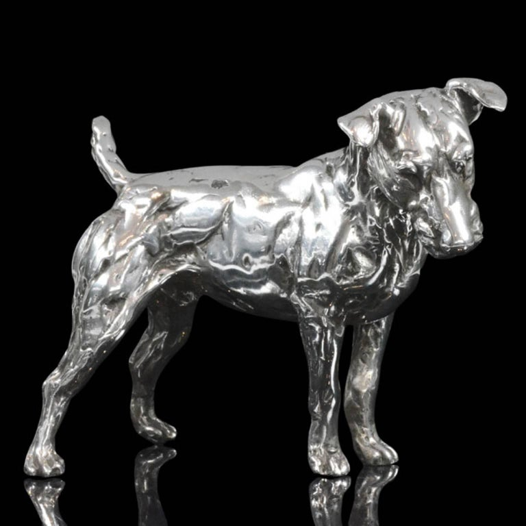 'Patterdale Terrier' in Sterling silver, Silver sculpture by Lucy Kinsella The limited edition finely modelled terrier stands squarely with his head cocked to one side, ears pricked and short tail pointing straight upwards. He stares intently at the