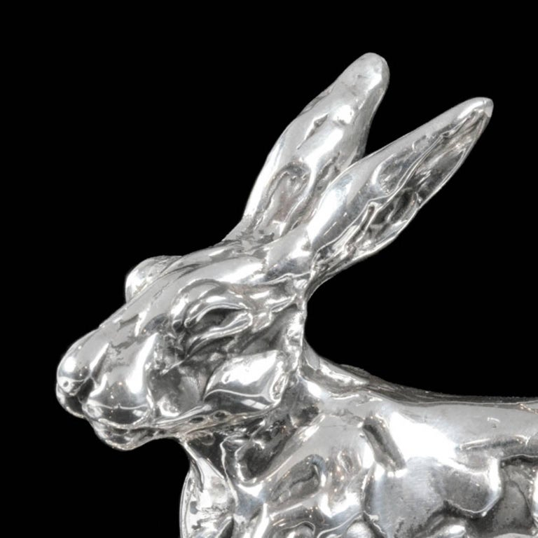 A 'Running Hare' sterling silver sculpture by Lucy Kinsella, the limited edition finely modelled hare depicted at full stretch bounding across the ground, his hind legs lengthening behind him, bob tail upright and head held high. He has been