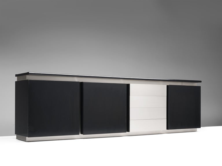 Ludovico Acerbis for Acerbis, sideboard, black lacquered wood and steel, 1970s, Italy.  Sleek and modern credenza in stainless steel and stained oak is designed by Ludocivo Acerbis (1939). This cabinet has both a contemporary yet monumental