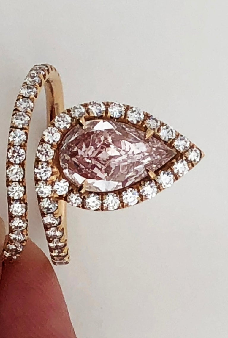 Gorgeous natural fancy light pink pear shape diamond weighing 1.72 ct with 1.00 ct of white diamond rounds in a handcrafted 18k rose gold mounting.   VS1 clarity. GIA certificate available.  Stone is exceptionally spready and has very strong color.