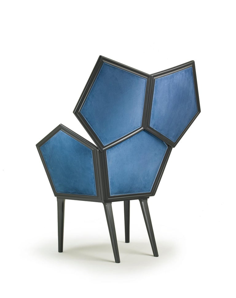 LUI 5/A armchair in blue leather by Philippe Bestenheider Fully upholstered armchair composed by pentagons. Outside and Inside central seat and back with leather Nabuk and side pentagons in fabric Regimen blue. Matt black lacquered
