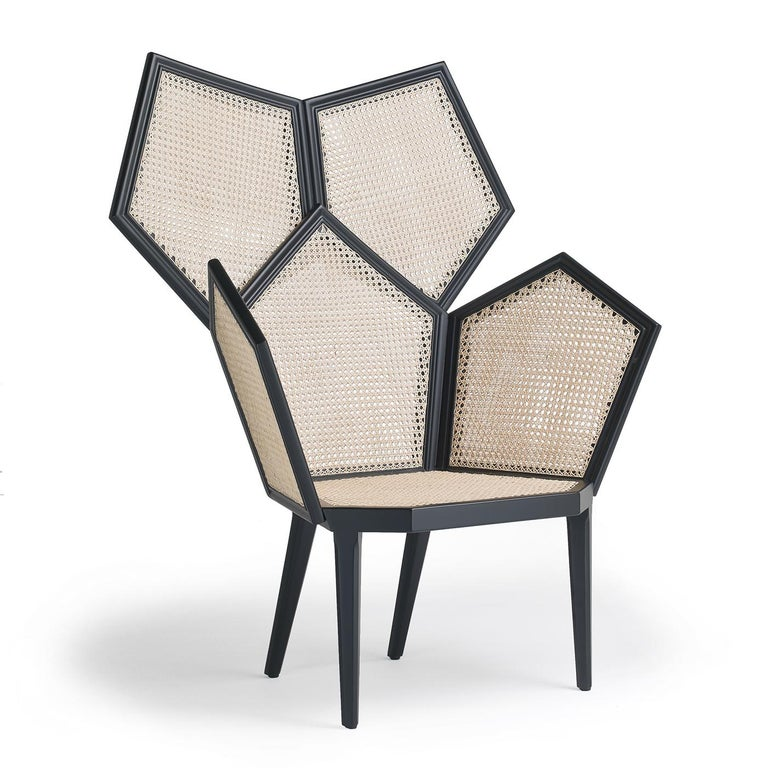 Part of the Lui collection of stunning modular armchairs, this piece celebrates the rigor and harmony of geometry with a unique structure in matte black lacquered wood that uses the pentagon as a primary element. From the pentagonal seat (40 cm