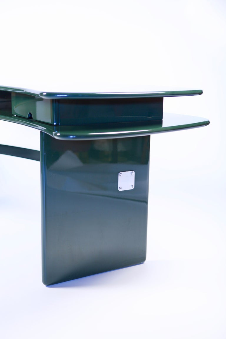 Luigi Caccia Dominioni, SCR7 writing desk with 2 offset surfaces in dark green lacquered wood, 2 drawers, band in polished chrome-plated brass. Edition Azucena, executed in Italy, 1979. This desk is a perfect example of the possibilities created by
