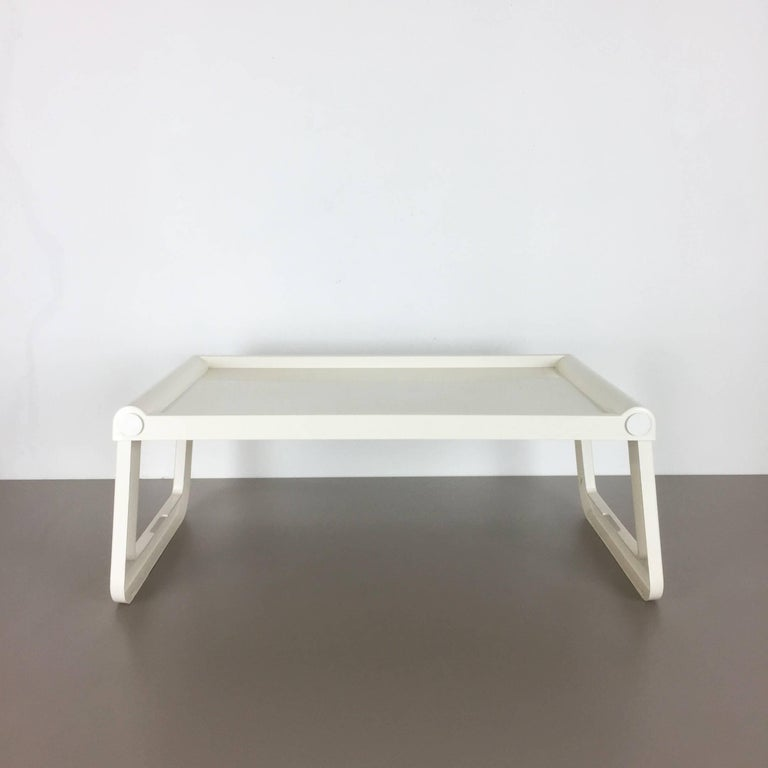 Article:  Plastic tray   Design:  Luigi Massoni   Producer:  Guzzini, Italy   Decade:  1980s   Description:  This tray table was designed by Luigi Massoni and produced by Guzzini in Italy in the 1980s. It is made from