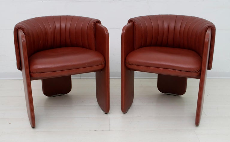 Luigi Massoni for Poltrona Frau. Two Dinette model cockpit armchairs entirely upholstered in leather, 1980s. Very rare!