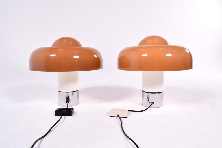 """Pair of """"Brumbury"""" table lamps designed by Luigi Massoni, manufactured in 1969 by Harvey Guzzini, Italy. Solid and stabile metal foot, white varnished and chrome-plated. The shade is in brown opal acrylic. Perfect for a nightstand or a living room,"""