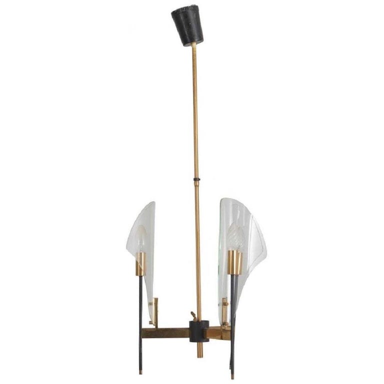 Long stem pendant chandelier by Luigi Molin, circa 1957, with three single lights of brass on a black enameled slender stem within a bent glass reflector all radiating from a central cluster hub. Rewired and ready to install. See our separate
