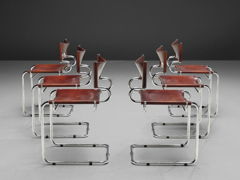 Luigi Saccardo for Arrmet, set of six 'Terrj' dining chairs, leather, chromed metal, Italy, 1970s  This set of six cantilever chairs consists of a tubular chromed steel frame with a red leather seat and back. The leather shows admirable patina