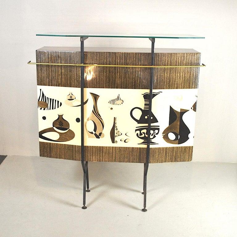 Lovely Italian dry bar designer Luigi Scremin. The lot includes two 1960s stools.