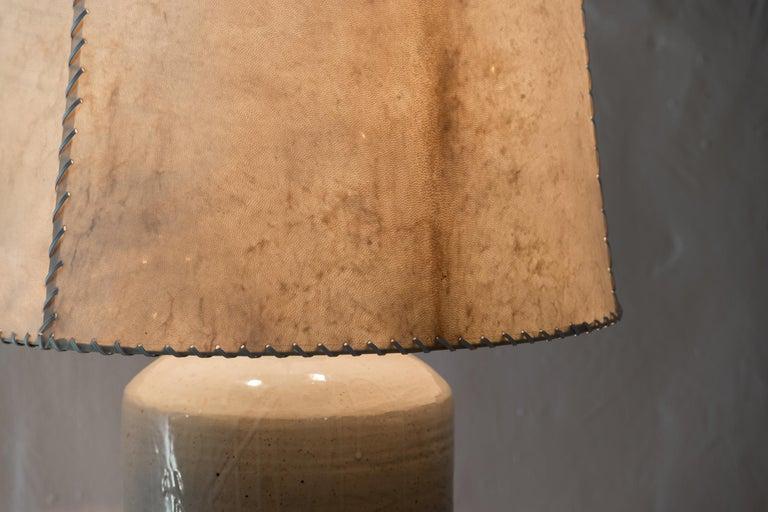 Luis Barragan (1902-1988)  Ceramic table lamp From Casa del Pedregal (Casa Prieto López) Manufactured by Hugo X. Velázquez México, 1952 Ceramic, parchment leather  Measurements: Total height 103 cm Vase height 58 cm Diameter 46