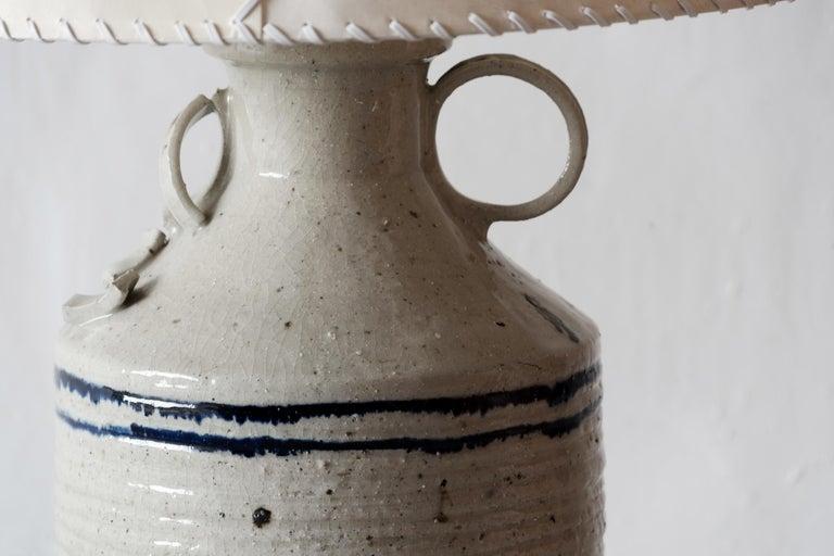 Luis Barragán(1902-1988)  Ceramic table lamp From Casa del Pedregal (Casa Prieto López) Manufactured by Hugo X. Velázquez México, 1952 Ceramic, parchment leather  Measurements Total height 85 cm Vase height 50 cm Diameter 38