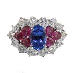 1,84 ct Ruby, ct 2,35 Tanzanite, ct 4,19 Diamond White Gold Ring