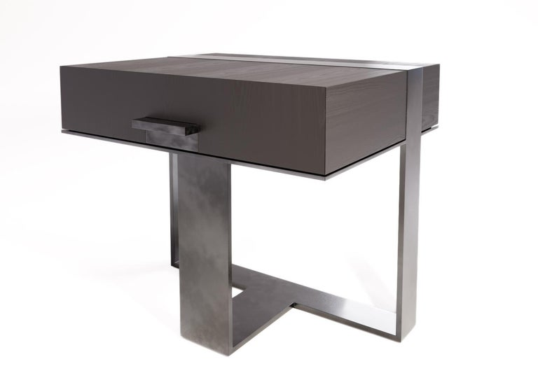 The LUMA Design Workshop strap nightstand is the result of thoughtful design and expert craftsmanship. A truffle oak top and drawer is supported by an antique steel strap leg and base. The hardware is also antique steel.