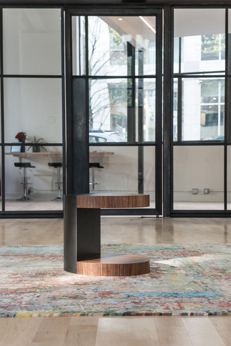 The LUMA design workshop silo occasional table is the result of thoughtful design and expert craftsmanship. Natural walnut veneer shelves effortlessly cantilever from a smoke powder coated steel base.  Like all LUMA Furniture, the silo occasional