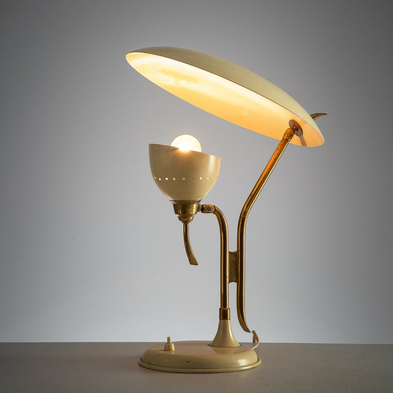 Lumen, table lamp, beige metal and brass, Italy, 1950s.