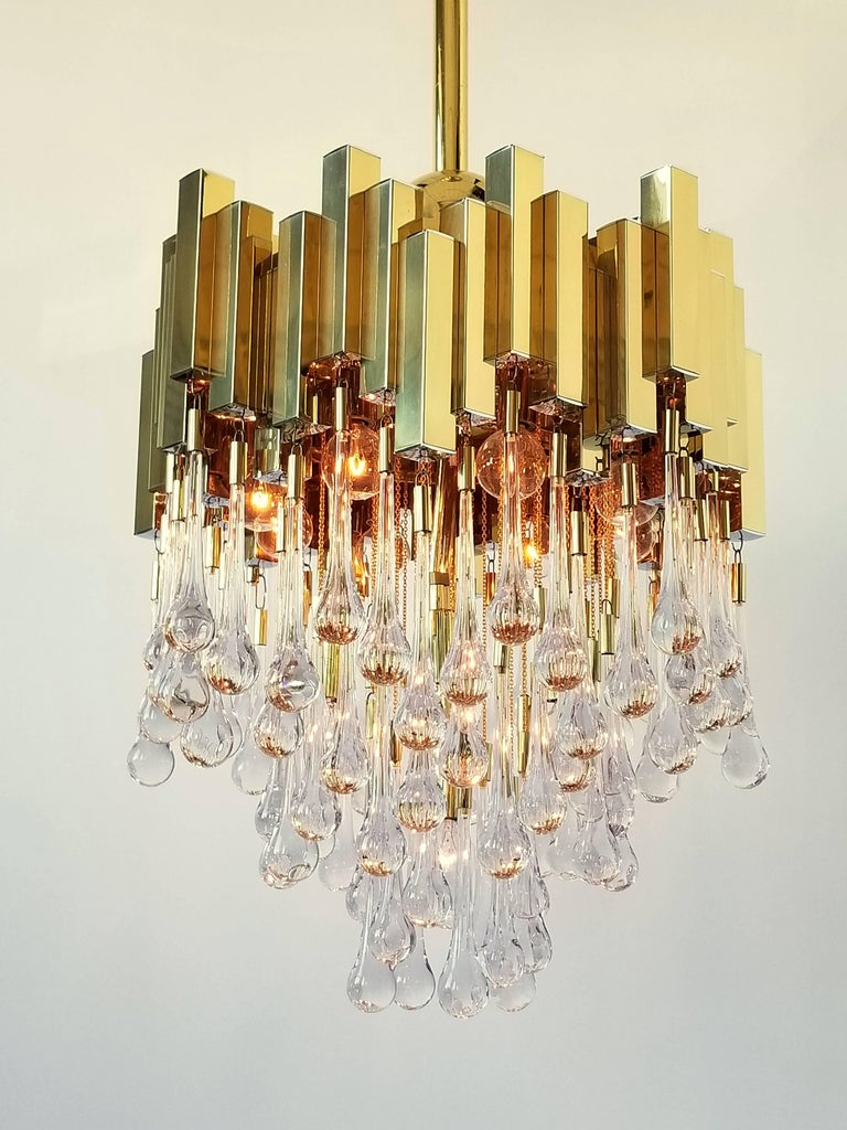An extremely rare Lumica Barcelona Teardrop chandelier in very good condition .   All  brass construction with superb  mouth blowed glass teardrop.   Well made with great attention to detail.   Contain 13   North American  E12 candelabra size socket