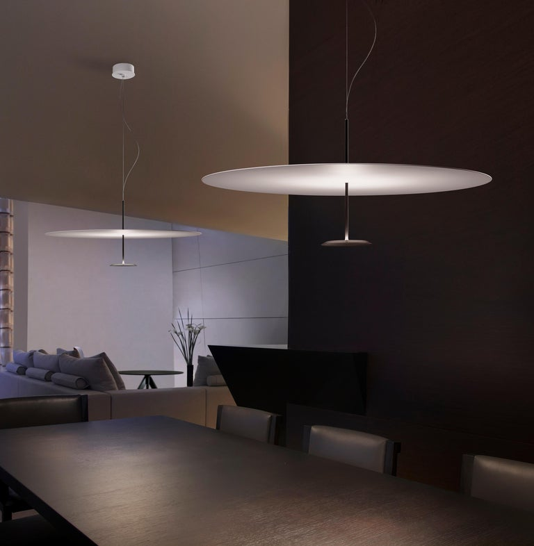 Suspended lamp for indirect lighting with a 20W LED source and diffused light optic system. aluminum structure with steel matt-painted reflector. This item is also available in a medium and large size on 1stdibs.