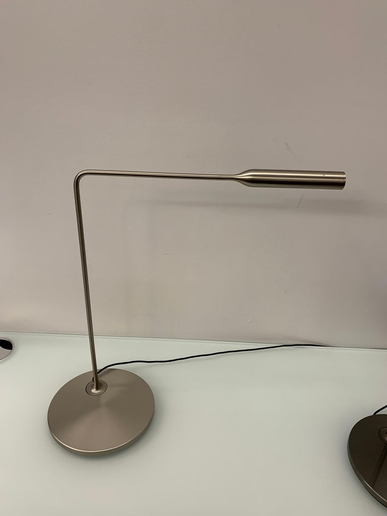 Flo desk Foster + Partners Task LED light in varnish coated aluminium and steel. Its head rotates by 300° for direct lighting, the arm pivots on base by 120°. 6W LED which you can switch on with one click for full light intensity, with two clicks
