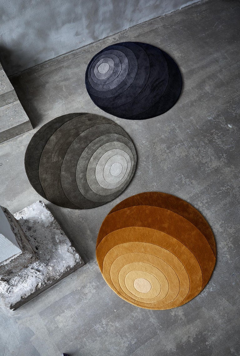 Eight colored rug with organic circle pattern designed by Verner Panton.  Material: 100% New Zealand wool Hand tufted  Color: Tone-in-tone dark yellow.