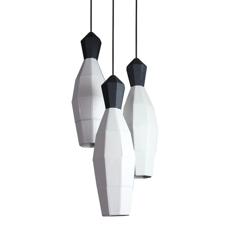 Broaden the look of diffused ambient lighting with the medium clustered hanging pendant lamps by The Bright Angle. These geometric, translucent porcelain shades are an updated alternative to the Classic chandelier. From the Chrysalis Family by The
