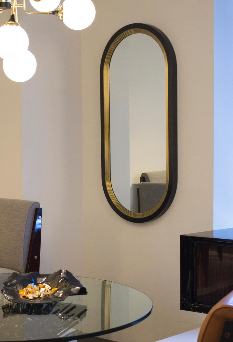 Inspired by the visual impact of archivolts used in cathedral architecture, the Luna mirror is a bold layering of solid brass arches. Each Luna is made-to-order to client specifications meaning that custom profiles are available on request.