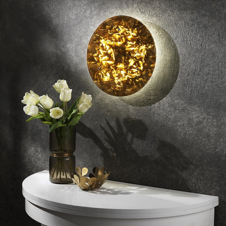 Meticulously handcrafted of Crystal Stone®, a crystalline alabaster unique to a quarry in Italy's Romagna region, this enchanting wall sconce captured the mysterious allure of the moon. The 55cm-diameter surface is sculpted in this translucent