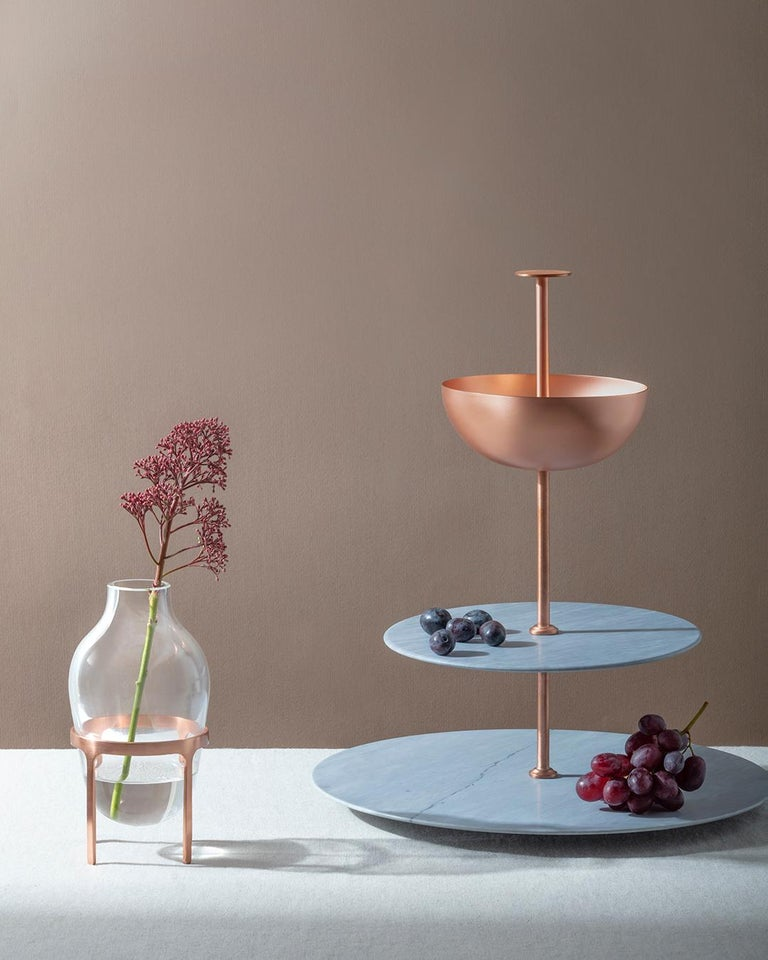 Lunar Cycle is a multi-layered stand made of two circular levels in Grigio Versilia – an Italian gray variety of marble – and a copper bowl, joined up by a thin copper elements. This Piece is part of the Lunar Landscape collection designed by Elisa