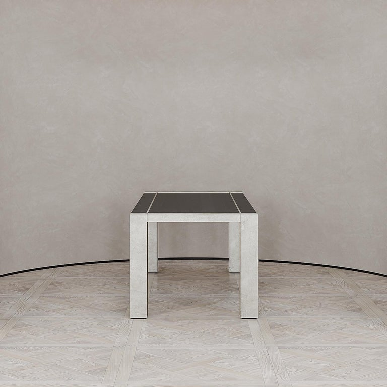 The Lunares dining table is designed by Emél & Browne in the Minimalist and contemporary style and custom made in Italy by skilled artisans.  The glowing lunarscape of the moon as it sits against the dark midnight sky is referenced in the