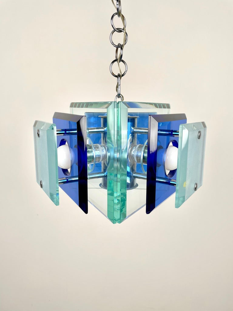 This is a three-light chandelier in chrome and blue and green heavy glass by Lupi Cristal Luxor, Italy, 1970s.  The original label is still attached as shown in photos.   Height with pendant: 80 cm.  Height without pendant: 24 cm.