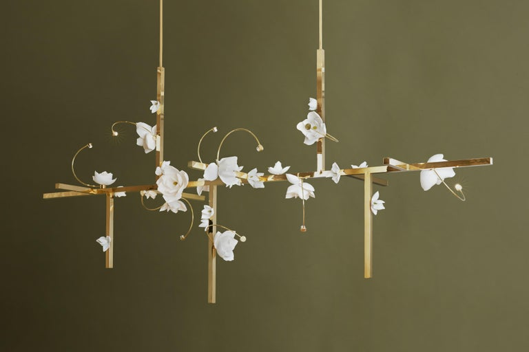Each blossom, a unique, delicate arrangement. At once open and closed, the flower's light and shadow lure one into its contemplative depths.  Lure transforms a flower's transient beauty into a lasting light. In this fixture, a cast cotton paper