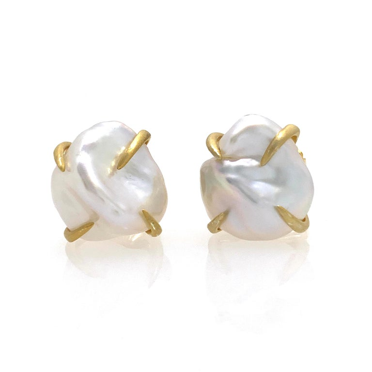 Beautiful pair of lustrous white baroque pearl stud earrings. The pair measures 12-13mm width, handset in 18k gold vermeil over sterling silver (matte finish). Straight post with large friction back allowing the earrings to sit well on the ear.