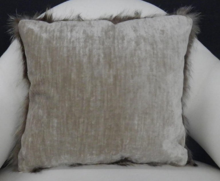 Luxurious down filled genuine Raccoon throw pillows. The furs have been fully refreshed are in great condition and filled with 50/50 down/down feathers. The backs are finished in a custom silk velvet. The pillows come in both 14