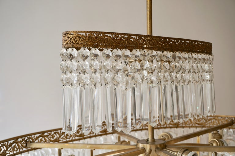 Luxurious Oval Shaped Crystal and Brass Hollywood Regency Chandelier For Sale 9