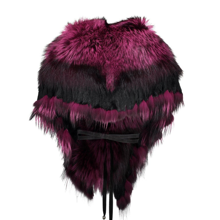 Pamper yourself with this rich luscious oversized Fuchsia stole accented with black. Wow! Get in touch with your glamorous side and stay warm. Crafted from the finest dyed Canadian Fox fur, fully lined and embellished with playful fringing and