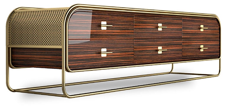 This modern sideboard features a stunning brushed brass frame and a structure made in ebony wood with a high gloss varnish finish hides. On the inside, an exciting and exotic interior storage with lacquered wood shelves with a high gloss varnish,