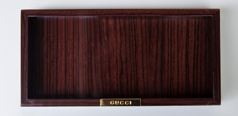 Elegant Gucci bowl in ebony and golden Gucci sign.