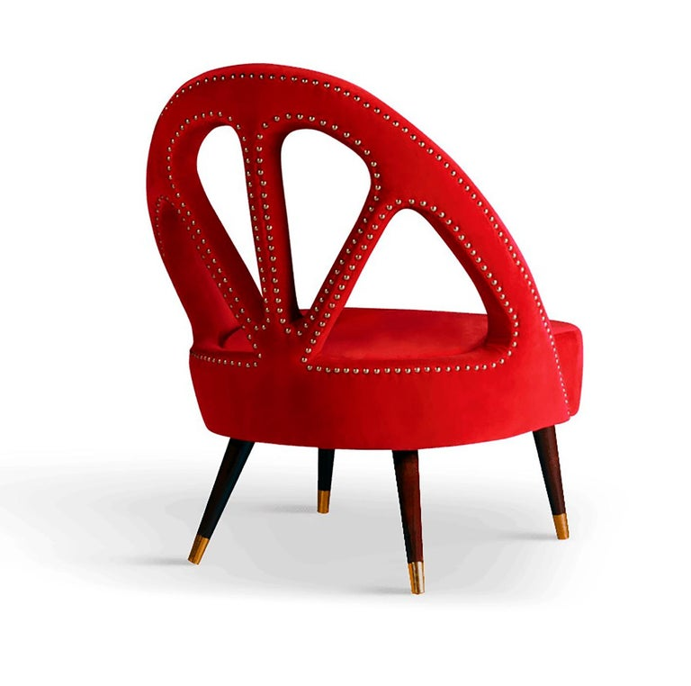 Red color emanates passion, love and seduction. Inspired by such color we created this luxurious upholstered red Milano Mid-Century Modern armchair. Its eclectic and unique back will give your living room set an entirely new character.