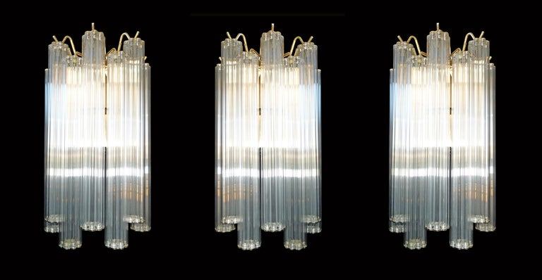 Measures: Width: 8 in/ 20 cm Height 13.7 in/ 32 cm Depth; 4 in/ 10 cm Weight: 4,5 Kg / 10 lb 1-light bulb E-27, 60w, good working condition/European wiring. 144/ 18 sets of 8 glass tubes each in 2 layers Also have macthing chandeliers and
