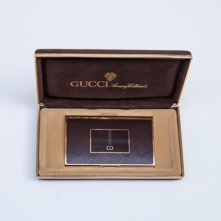 Luxury vintage Gucci business card holder in perspex and brass covered in original box from the Gucci accessory collection signed with the golden Gucci sign.