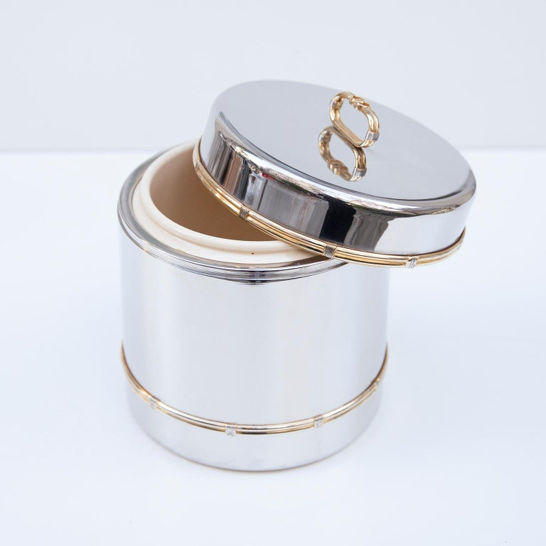 Luxury vintage Gucci ice bucket in chrome and brass with and plastic inlay and marked with the golden Gucci sign from the 1970s and on the bottom.