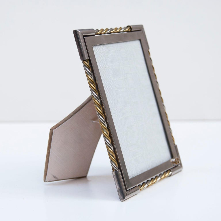 Luxury vintage Gucci picture frame in chrome an brass with the golden Gucci sign.