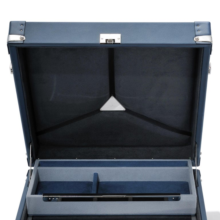 Suitcase luxury watch blue covered with blue cowhide leather sheathing, box with details and finishings in polished nickel-plated brass. Upholstery and padding in dinamica Slate black and silver grey microfiber. With three foamed housings for
