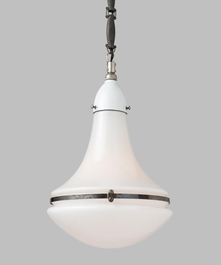 Luzette pendant by Peter Behrens, Germany, circa 1920.  Small pendant with opaline glass top and bottom, secured with enameled fitter and copper brace. Comes with original chain and canopy. Manufactured by AEG Siemens with manufacturer's mark.