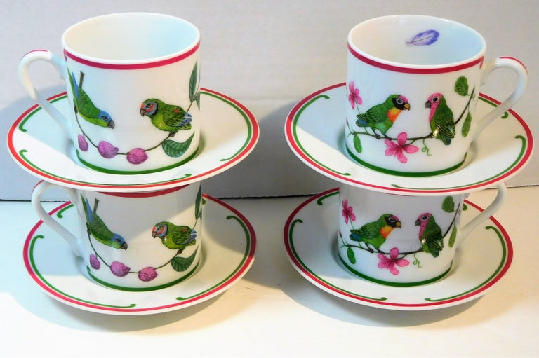 This colorful set of four porcelain demitasse cups and saucers ( 8 pieces total) was made by Lynn Chase Designs, Inc. of Massachusetts in 1989. The colors include green, fuchsia, orange, red, purple. blue and black on a white ground, so the colors