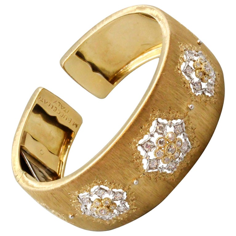 Timeless diamond and 18K yellow gold wide cuff bracelet by Mario Buccellati. It features high grade round brilliant cut diamonds along with their trademark lattice style gold design with the signature Florentine satin-like finish. Expert workmanship