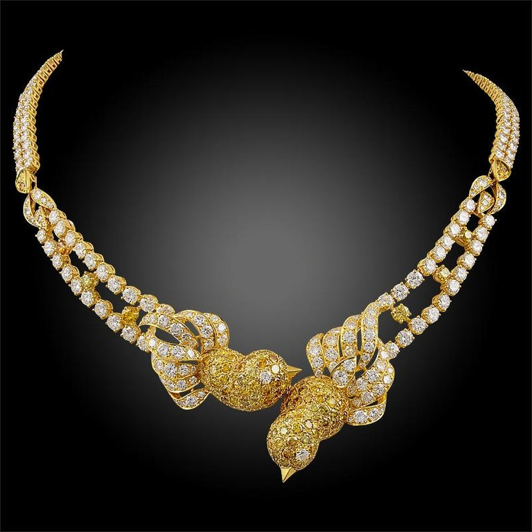 A remarkable and chatoyant suite by M. Gerard comprising a necklace, ring and ear clips designed as bird motifs, finely crafted in 18k yellow gold, adorned with an opulence of fancy yellow and white diamonds throughout. The fancy yellow diamonds