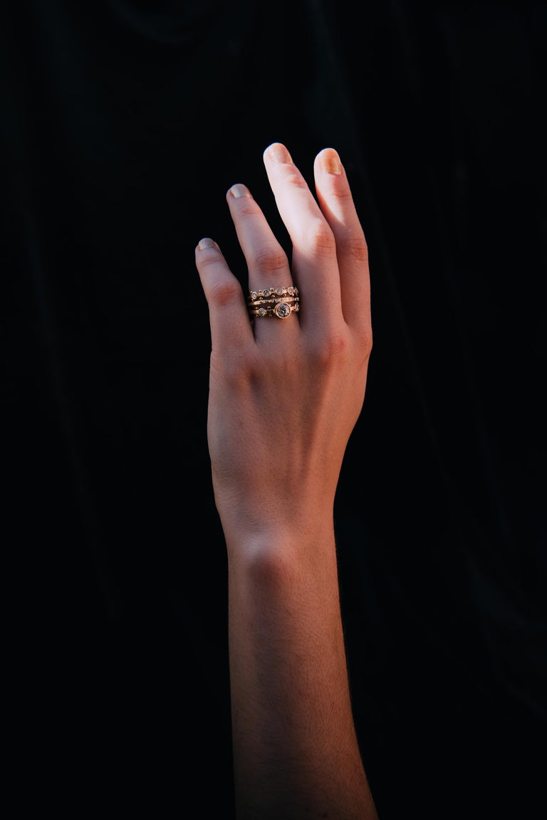 Misao: one of the earliest M. Hisae designs. Slight asymmetry complements a bold center point. Solid and of substance, a perfect comfort feel. Can be worn alone or nested alongside the Mado Band.  US SIZE 7 14K YELLOW GOLD READY TO SHIP *Resizing