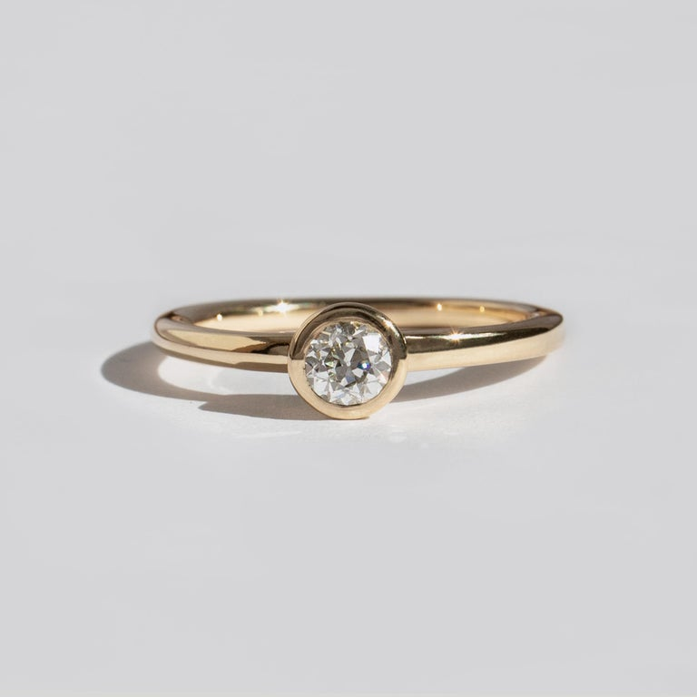 The dynamic band, an M. Hisae signature, now as a stand-out solitaire. A beautiful genesis of movement out of static, geometric forms. See also the Carré Cut version.  STONES ◘  0.25ct Antique Old European Cut White Diamond (VS, G-H) ◘  Diamond is