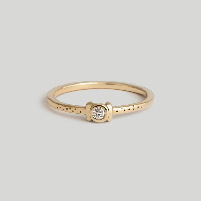Visions of an unorthodox commitment ring ― hand-scribed speckle detailing gives the Catori a slightly primitive, slightly mysterious story.  STONES ◘ 2mm brilliant-cut White Diamond ◘ Diamond is reclaimed and fair trade  MATERIAL ◘ 1.3mm square