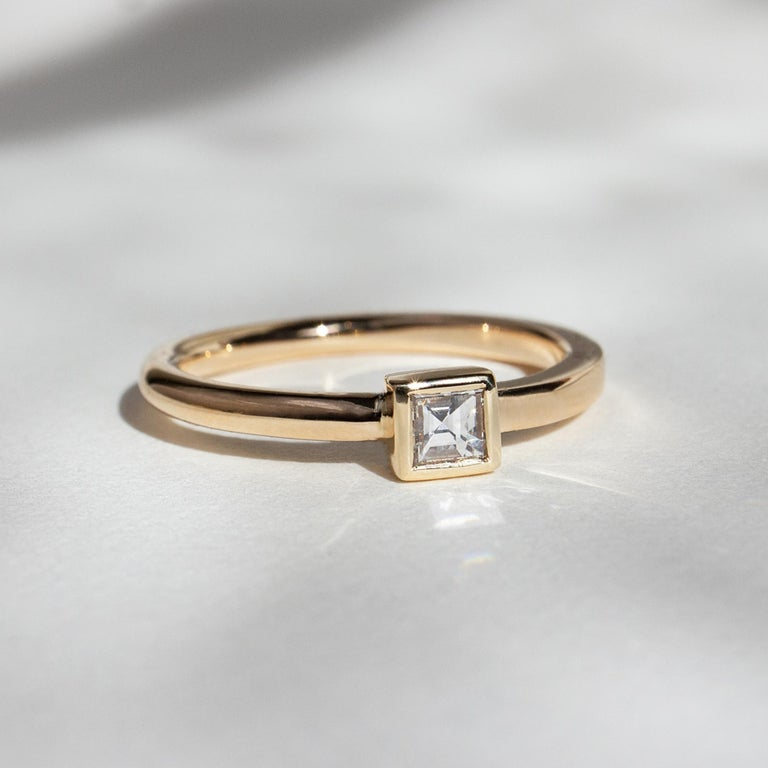 The dynamic band, an M. Hisae signature, now as a stand-out solitaire. A beautiful genesis of movement out of static, geometric forms. The Carré Cut is an original antique. Availability for this carat size fluctuates. Please contact me for current